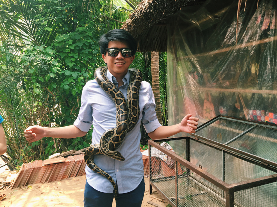Carrying a snake on my shoulder | Mekong River Tour